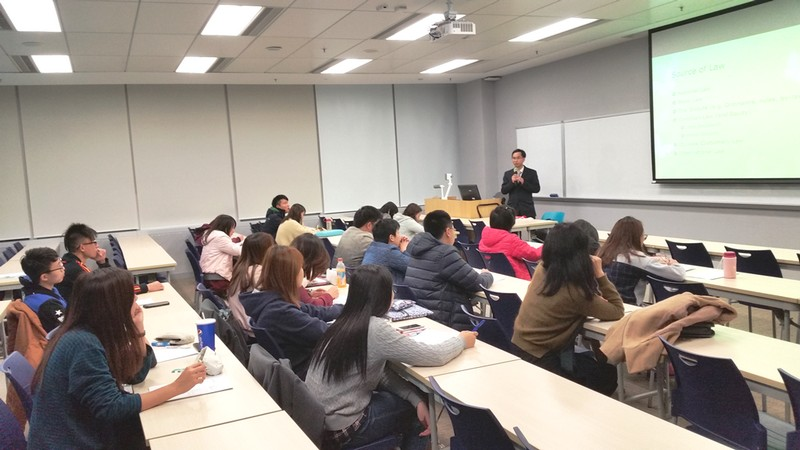 [:The speaker explains the legal system in Hong Kong to the audience